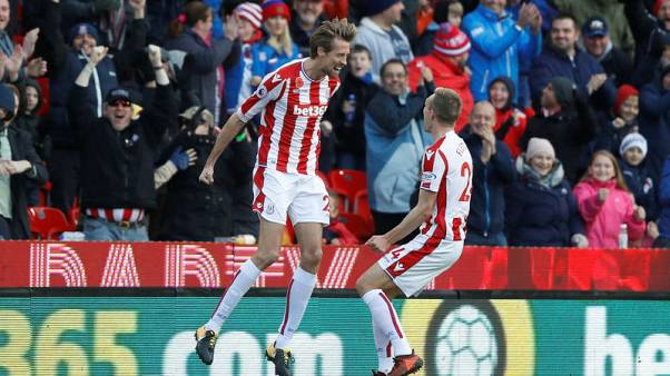 Crouch comes off the bench to snatch a point for Stoke