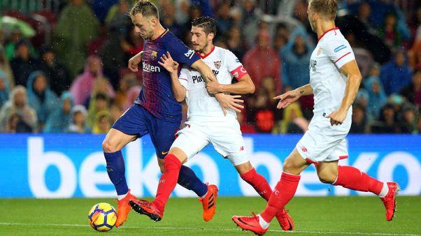 Alcacer scores twice as Barca sink Sevilla