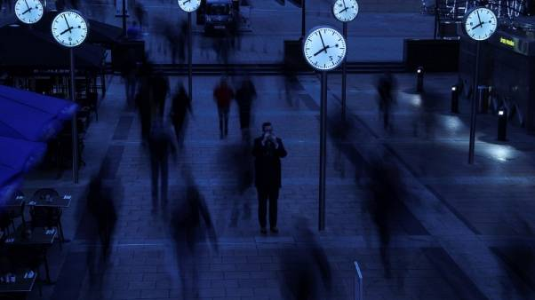 FILE PHOTO -  Workers walk to work during the morning rush hour in the financial district of Canary Wharf in London, Britain, January 26, 2017.  REUTERS/Eddie Keogh/File Photo