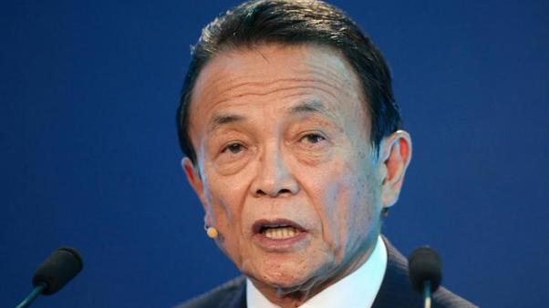 FILE PHOTO: Taro Aso, Deputy Prime Minister, Minister of Finance and Minister of State for Financial Services of Japan, speaks during the Milken Institute Global Conference in Beverly Hills, California, U.S., May 1, 2017. REUTERS/Lucy Nicholson/File Photo