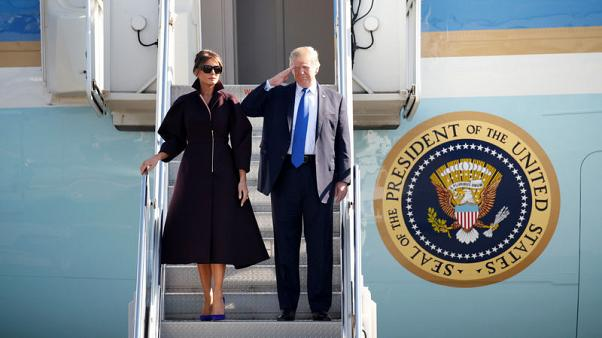 U.S. President Donald Trump and first lady Melania board Air Force One as they depart for Seoul, at U.S. Air Force Yokota base in Fussa, on the outskirts of Tokyo, Japan, November 7, 2017. REUTERS/Toru Hanai