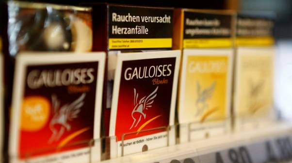 Packs of Gauloises cigarettes are on display in a tobacco shop in Vienna, Austria, May 12, 2017.  REUTERS/Leonhard Foeger