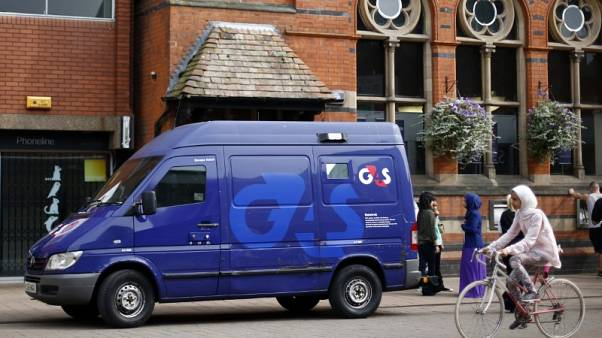 FILE PHOTO - A G4S security van is seen parked outside a bank in Loughborough, central England, August 28, 2013. REUTERS/Darren Staples/File Photo