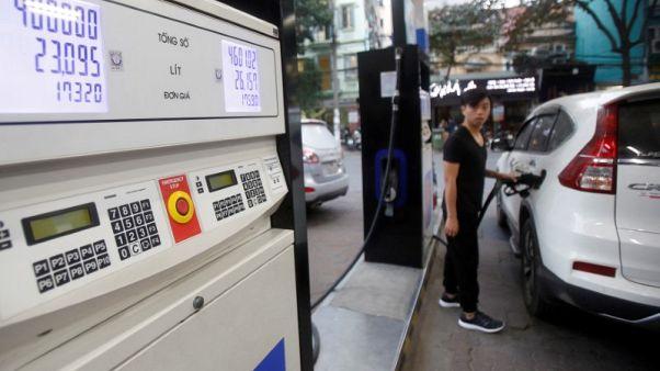 FILE PHOTO: A man pumps petrol for his car at a petrol station in Hanoi, Vietnam December 20, 2016. REUTERS/Kham/File Photo