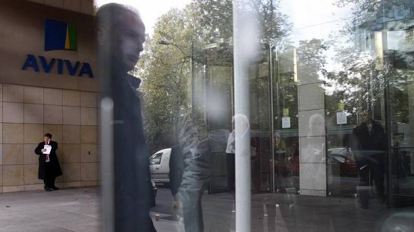 A man is reflected in a window near the entrance to the AVIVA headquarters building in Dublin October 19, 2011. REUTERS/Cathal McNaughton