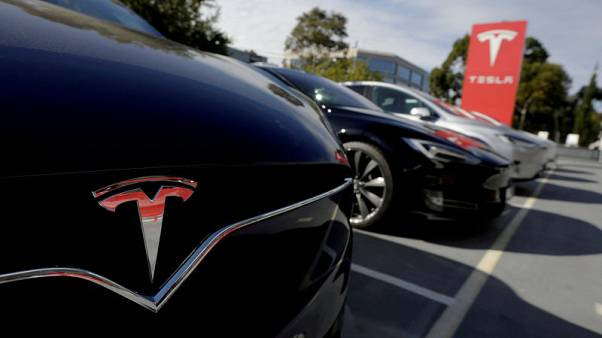 FILE PHOTO: A Tesla Model X is seen alongside a Model S at a Tesla electric car dealership in Sydney, Australia on May 31, 2017.  REUTERS/Jason Reed/File Photo