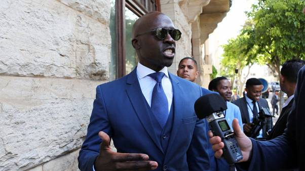 Finance Minister Malusi Gigaba speaks to members of the media after delivering his medium term budget speech in Parliament, in Cape Town, South Africa, October 25, 2017. REUTERS/Sumaya Hisham