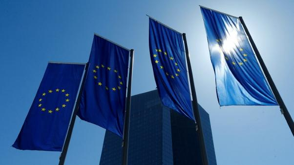 FILE PHOTO: European Union flags flutter outside the headquarters of the European Central Bank (ECB) in Frankfurt, Germany, April 21, 2016. REUTERS/Ralph Orlowski/File Photo