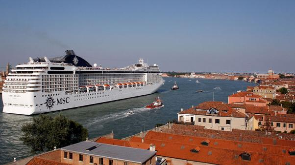 Italy moves to force big ships to take back route to Venice
