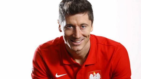 Poland's national soccer team captain Robert Lewandowski poses for a picture after an interview with Reuters at a hotel in Warsaw, Poland November 7, 2017. REUTERS/Kacper Pempel