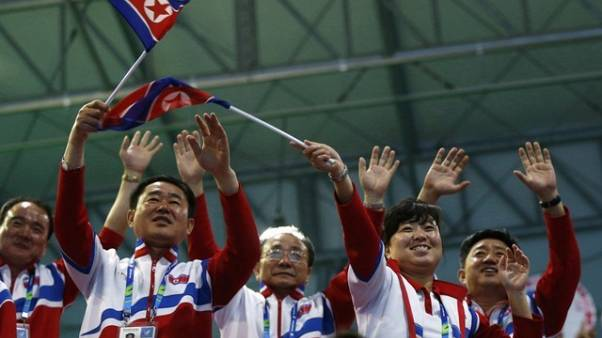 FILE PHOTO - North Korean spectators cheer for North Korea's Kim Un Guk as he competes in the men's 62kg weightlifting competition at the Moonlight Garden Venue during the 17th Asian Games in Incheon September 21, 2014. REUTERS/Olivia Harris