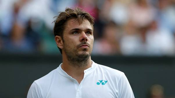 FILE PHOTO - Tennis - Wimbledon - London, Britain - July 3, 2017   Switzerland's Stan Wawrinka reacts during his first round match against Russia's Daniil Medvedev    REUTERS/Andrew Couldridge