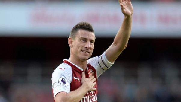 FILE PHOTO - Soccer Football - Premier League - Arsenal vs AFC Bournemouth - London, Britain - September 9, 2017  Arsenal's Laurent Koscielny celebrates after the match. Action Images via Reuters/Alan Walter