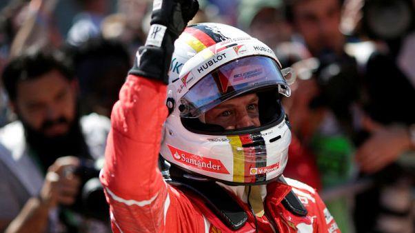 Formula One F1 - Brazilian Grand Prix 2017 - Sao Paulo, Brazil - November 12, 2017  Ferrari's Sebastian Vettel celebrates winning the race  REUTERS/Ueslei Marcelino