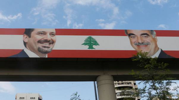 A poster depicting Lebanon's Prime Minister Saad al-Hariri, who has resigned from his post, and his father, Rafik al-Hariri, is seen in the mainly Sunni Beirut neighbourhood of Tariq al-Jadideh in Beirut, Lebanon November 6, 2017. REUTERS/Mohamed Azakir