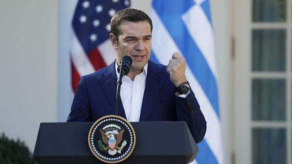 Greek Prime Minister Alexis Tsipras speaks as he holds a joint news conference with U.S. President Donald Trump in the Rose Garden of the White House in Washington, U.S., October 17, 2017. REUTERS/Kevin Lamarque