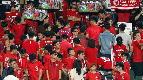 Hong Kong fans turn their backs and boo during Chinese national anthem, at the Asian Cup preliminary match between Hong Kong and Lebanon in Hong Kong, China November 14, 2017.  REUTERS/Bobby Yip