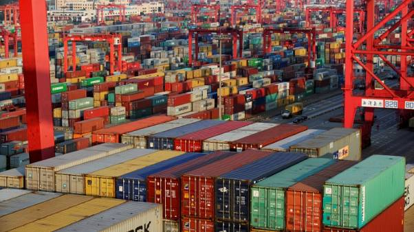 FILE PHOTO: Container boxes are seen at the Yangshan Deep Water Port, part of the Shanghai Free Trade Zone, in Shanghai, China September 24, 2016.  REUTERS/Aly Song/File Photo