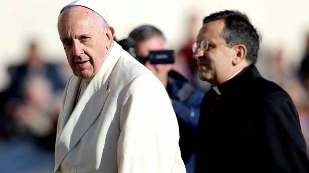 Pope Francis looks as he arrives during his Wednesday general audience in Saint Peter's square at the Vatican, November 8, 2017. REUTERS/Alessandro Bianchi