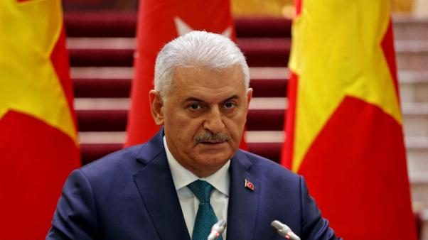 FILE PHOTO - Turkish Prime Minister Binali Yildirim attends a press briefing with his Vietnamese counterpart Nguyen Xuan Phuc (not pictured) at the Government Office in Hanoi, Vietnam August 23, 2017. REUTERS/Kham