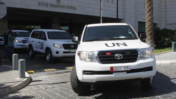 FILE PHOTO: U.N. vehicles transport a team of United Nations chemical weapons experts in Damascus September 30, 2013. REUTERS/Khaled al-Hariri
