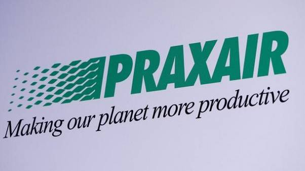 The Praxair logo is seen during a news conference with Linde in Munich, Germany, June 2, 2017. REUTERS/Michaela Rehle