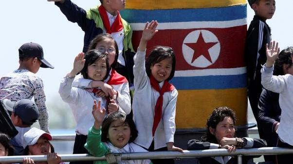 North Korean children wave during their tour on the Yalu River in Sinuiju, near the Chinese border city of Dandong, May 8, 2016.  REUTERS/Jacky Chen