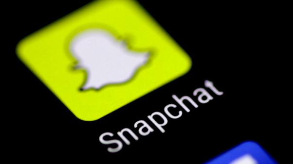 FILE PHOTO: The Snapchat messaging application is seen on a phone screen August 3, 2017.   REUTERS/Thomas White/File Photo                          GLOBAL BUSINESS WEEK AHEAD - SEARCH GLOBAL BUSINESS 6 NOV FOR ALL IMAGES