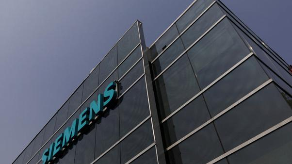 FILE PHOTO: A logo of Siemens is pictured on a building in Mexico City, Mexico, May 16, 2017. REUTERS/Edgard Garrido/File Photo                          GLOBAL BUSINESS WEEK AHEAD - SEARCH GLOBAL BUSINESS 6 NOV FOR ALL IMAGES