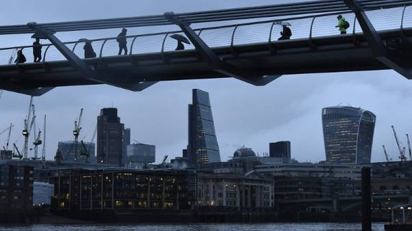 City workers cross the Millennium footbridge in the financial district of London, Britain January 7, 2016. REUTERS/Toby Melville