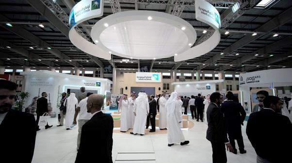 FILE PHOTO: Visitors are seen at the Saudi Aramco stand at the Middle East Process Engineering Conference & Exhibition in Manama, Bahrain, October 9, 2016. REUTERS/Hamad I Mohammed/File photo