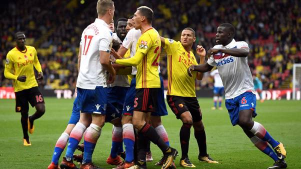 Soccer Football - Premier League - Watford vs Stoke City - Vicarage Road, Watford, Britain - October 28, 2017   Stoke City's Ryan Shawcross clashes with Watford's Jose Holebas and Troy Deeney    Action Images via Reuters/Tony O'Brien