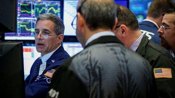Traders work on the floor of the New York Stock Exchange (NYSE) in New York, U.S., October 26, 2017. REUTERS/Brendan McDermid