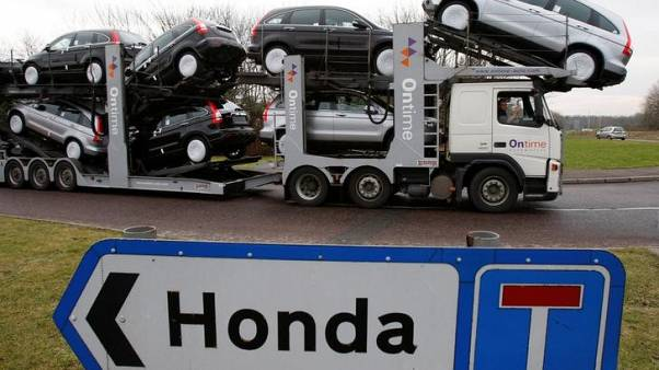 FILE PHOTO: A new car transporter leaves the Honda manufacturing plant in Swindon, western England January 30, 2009.  REUTERS/Stephen Hird/File Photo