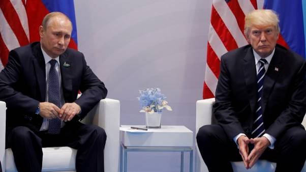 FILE PHOTO: U.S. President Donald Trump meets with Russian President Vladimir Putin during their bilateral meeting at the G20 summit in Hamburg, Germany July 7, 2017. REUTERS/Carlos Barria/File Photo