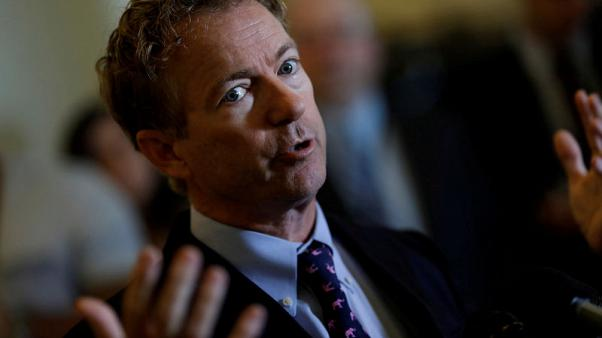 FILE PHOTO: Sen. Rand Paul (R-KY) speaks at a press conference about the latest Republican Effort to repeal and replace the Affordable Care Act on Capitol Hill in Washington, U.S. September 25, 2017. REUTERS/Aaron P. Bernstein/File Photo