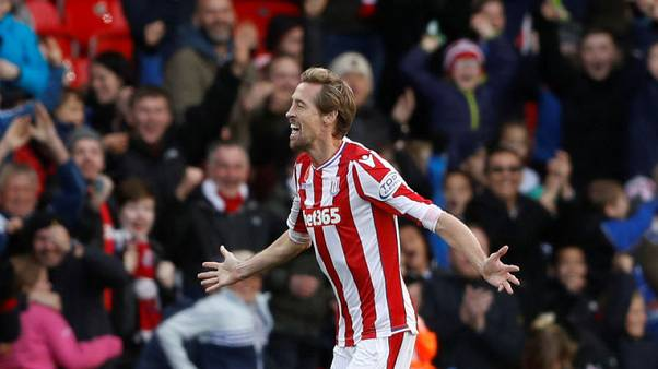 FILE PHOTO - Soccer Football - Premier League - Stoke City vs Leicester City - bet365 Stadium, Stoke-on-Trent, Britain - November 4, 2017   Stoke City's Peter Crouch celebrates scoring their second goal.  Action Images via Reuters/Carl Recine