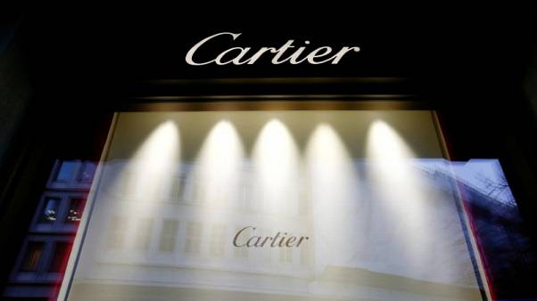 FILE PHOTO - The logo of luxury goods group Richemont's flagship brand Cartier is seen at a branch in Zurich, Switzerland, January 12, 2017.  REUTERS/Arnd Wiegmann