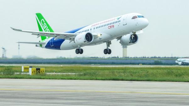 FILE PHOTO - China's domestically developed C919 passenger jet takes off on its second test flight at Pudong International Airport in Shanghai, China September 28, 2017. China Daily via REUTERS