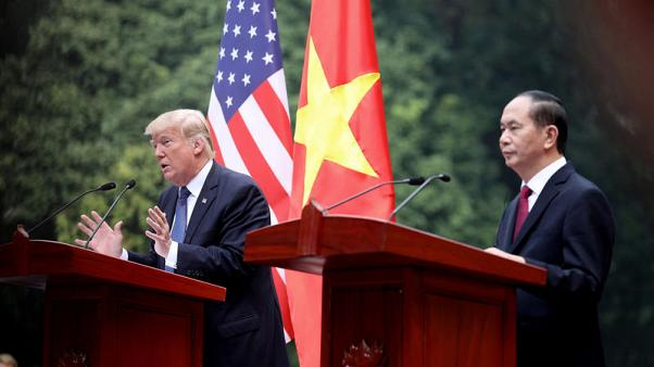 US President Donald J. Trump (L) speaks as his Vietnamese counterpart Tran Dai Quang (R) listens during a press conference at the Presidential Palace in Hanoi, Vietnam, 12 November 2017.  REUTERS/Luong Thai Linh/Pool