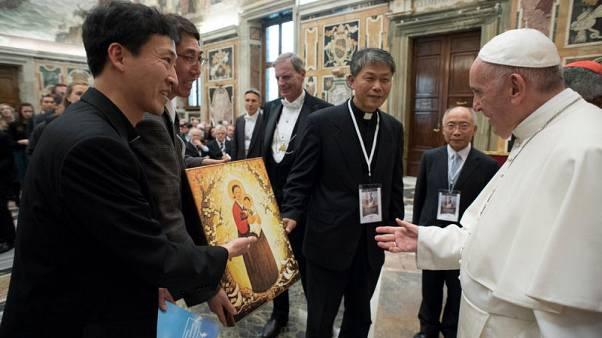 "Pope Francis receives a gift during a special audience with participants to the conference ""Perspectives for a World Free from Nuclear Weapons and for Integral Disarmament"" at the Vatican November 10, 2017.  Osservatore Romano/Handout via Reuters"