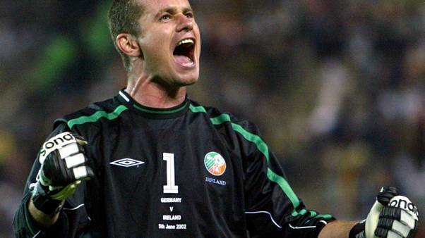 FILE PHOTO: Ireland's goalkeeper Shay Given celebrates at the end of the Group E match against Germany at the World Cup Finals in Ibaraki, Japan, June 5, 2002.  REUTERS/Mark Baker/File Photo