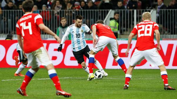 Soccer Football - International Friendly - Russia vs Argentina - Luzhniki Stadium, Moscow, Russia - November 11, 2017   Argentina's Lionel Messi in action with Russia's Viktor Vasin    REUTERS/Sergei Karpukhin