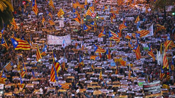 Protesters hold banners during a demonstration called by pro-independence associations asking for the release of jailed Catalan activists and leaders, in Barcelona, Spain, November 11, 2017. REUTERS/Albert Gea
