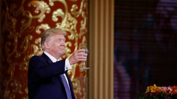 FILE PHOTO - President Trump attends a state dinner at the Great Hall of the People in Beijing. REUTERS/Thomas Peter