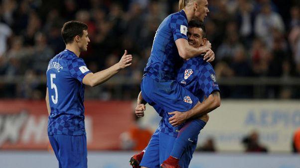 Soccer Football - 2018 World Cup Qualifications - Europe - Greece vs Croatia - Karaiskakis Stadium, Piraeus, Greece - November 12, 2017   Croatia's Domagoj Vida and Croatia's Dejan Lovren celebrate after the match   REUTERS/Costas Baltas