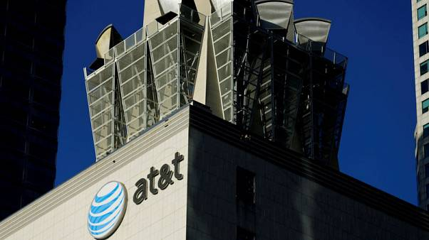 FILE PHOTO:    An AT&T logo and communication equipment is shown on a building in downtown Los Angeles, California October 29, 2014.    REUTERS/Mike Blake/File Photo