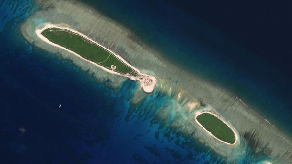 FILE PHOTO: Satellite photo shows Chinese-controlled North Island, part of the Paracel Islands group in the South China Sea, on September 29, 2017. Planet Labs/Handout via REUTERS