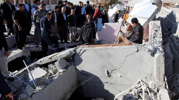 Residents gather near a damaged building following an earthquake in the town of Darbandikhan, near the city of Sulaimaniyah, in the semi-autonomous Kurdistan region, Iraq November 13, 2017. REUTERS/Ako Rasheed