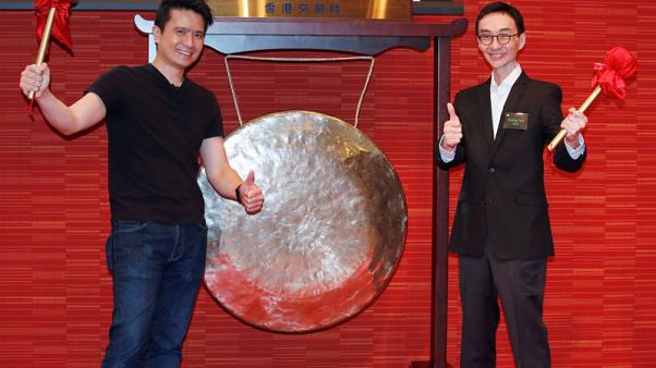 Min-Liang Tan (L), co-founder and CEO of Razer, and Kaling Lim, non-executive director, pose during the debut of the company at the Hong Kong Exchanges in Hong Kong, China, November 13, 2017.      REUTERS/Bobby Yip